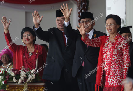 Susilo Bambang Yudhoyono Indonesian President Susilo Bambang Yudhoyono, second left, his wife Ani, left, Vice President Boediono, second right, and his wife Herawati wave to the crowds at the end of a flag hoisting ceremony commemorating the country's independence day at Merdeka Palace in Jakarta, Indonesia