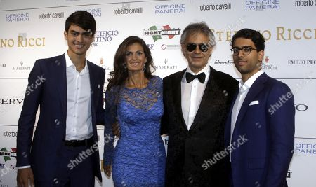 "Andrea Bocelli, second right, and his wife Veronica Berti pose for photographers with their sons Amos, right, and Matteo, left, as they arrive for the ""Celebrity Fight Night"" foundation gala dinner, in Florence, Italy"