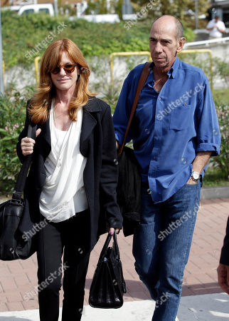Stock Picture of Miguel Ferrer, Lori Weintraub Actor Miguel Ferrer, right, and his wife Lori Weintraub, arrive at Venice's airport, . Actor director George Clooney revealed earlier this month at a star-studded benefit in Florence that he would marry human rights lawyer Amal Alamuddin in the lagoon city, but refrained from giving the date