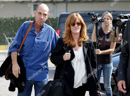 Miguel Ferrer, Lori Weintraub Actor Miguel Ferrer, left, and his wife Lori Weintraub, arrive at Venice's airport, . Actor director George Clooney revealed earlier this month at a star-studded benefit in Florence that he would marry human rights lawyer Amal Alamuddin in the lagoon city, but refrained from giving the date