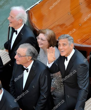 George Clooney, Ramzi Alamuddin, Nick Clooney, Adelia Zeidler Actor George Clooney, right, waves from a boat with, from left, his father Nick Clooney, Ramzi Alamuddin, father of her fiancee Amal Alamuddin, and his sister Adelia Zeidler, on their way to the Aman hotel ahead of his wedding in Venice, Italy