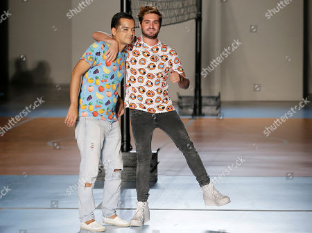 Stock Photo of Fashion designers Diego Marquez, left, and Mirko Fontana acknowledge the applause at the end of their Au Jour Le Jour women's Spring Summer 2015 collection, part of the Milan Fashion Week, unveiled in Milan, Italy