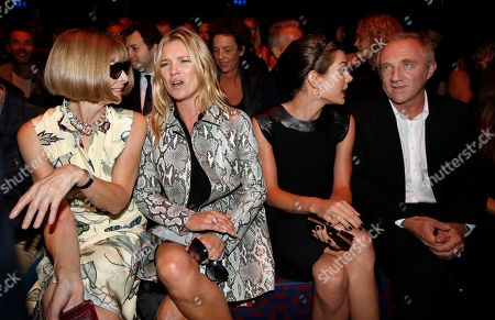 From left, editor-in-chief of American Vogue Anna Wintour, model Kate Moss, Princess Charlotte Casiraghi, and French businessman Francois Pinault attend Gucci women's spring-summer 2015 show, part of the Milan Fashion Week, unveiled in Milan, Italy