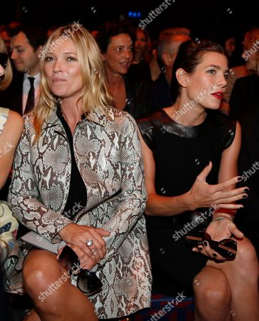 British model Kate Moss, left is flanked by Princess Charlotte Casiraghi at the start of Gucci women's spring-summer 2015 show, part of the Milan Fashion Week, unveiled in Milan, Italy