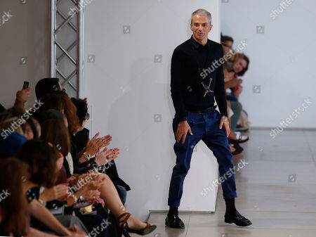 Fashion designer Rodolfo Paglialunga acknowledges the applause of the audience at the end of Jil Sander women's spring-summer 2015 show, part of the Milan Fashion Week, unveiled in Milan, Italy