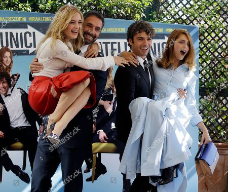 """From left, actors Carolina Crescentivi, Raul Bova, Luca Argentero and Miriam Leone pose for photographers during a photo call of the movie """"Fratelli Unici"""" in Rome"""