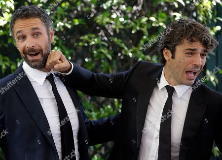 """Actors Raul Bova, left, and Luca Argentero pose for photographers during a photo call of the movie """"Fratelli Unici"""" in Rome"""