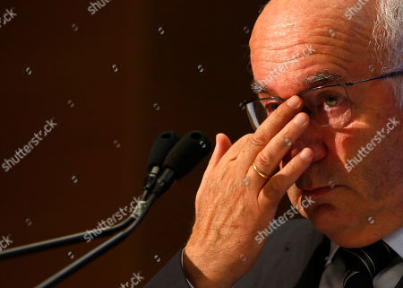 Italian Soccer Federation (FIGC) newly elected president Carlo Tavecchio adjusts his glasses at the end of the national elective assembly at Fiumicino, near Rome, . Carlo Tavecchio has been elected the new president of the Italian football federation, replacing Giancarlo Abete. Despite allegations of racism marring his electoral campaign, Tavecchio beat Demetrio Albertini by a majority vote on Monday
