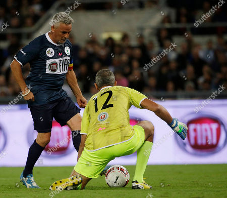Italian soccer legend Roberto Baggio scores past goalie Francesco Toldo during an inter-religious soccer match for peace, supported by Pope Francis to promote the dialogue and peace among different religions, at Rome's Olympic Stadium