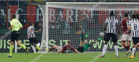 Juventus' Carlos Tevez, left, scores past by AC Milan goalkeeper Christian Abbiati during a Serie A soccer match between AC Milan and Juventus, at the San Siro stadium in Milan, Italy