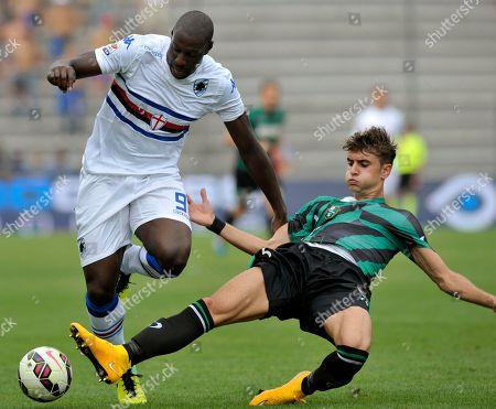 Sassuolo's Luca Antei, right, competes for the ball with Sampdoria's Stefano Okaka, during their Serie A soccer match at Reggio Emilia's Mapei stadium, Italy