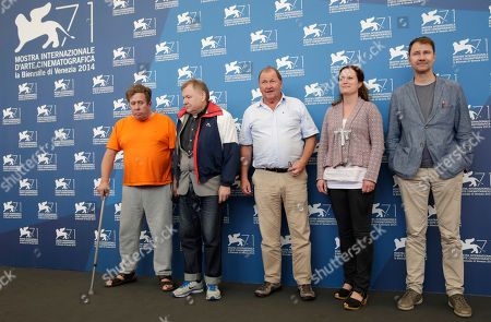 From left, actors Nils Westblom, Holger Andersson, director Roy Andersson, producer Pernilla Sandstrom and line producer Johan Carlsson pose for photographers during a photo call for A Pigeon Sat on a Branch Reflecting on Existence at the 71st edition of the Venice Film Festival in Venice, Italy