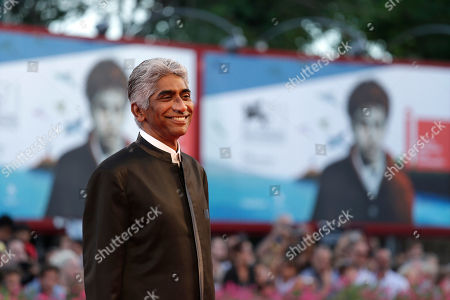 Ashok Amritraj Producer Ashok Amritraj poses for photographers as he arrives for the screening of 99 Homes during the 71st edition of the Venice Film Festival in Venice, Italy