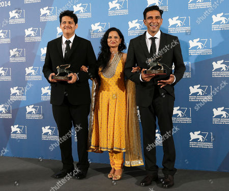 Geetanjali Kulkarni, Chaitanya Tamhane, Vivek Gomber From left, director Chaitanya Tamhane, actors Geetanjali Kulkarni and Vivek Gomber, pose with the two prizes they won for best film in the Orizzonti section, and for best debut film with the movie Court, during a photo call at the 71th edition of the Venice Film Festival in Venice, Italy