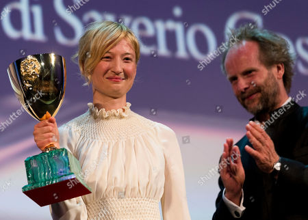 Alba Rohrwacher, Philip Groning Actress Alba Rohrwacher shows the Coppa Volpi for best actress for her role in the movie Hungry Hearts, as jury member Philip Groning, right, applaudes her, during the awards ceremony of the 71th edition of the Venice Film Festival in Venice, Italy