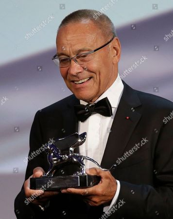 Andrej Koncalovskij Director Andrej Koncalovskij reacts after receiving the Silver Lion for best director for the movie The Postman's White Nights during the awards ceremony of the 71th edition of the Venice Film Festival in Venice, Italy