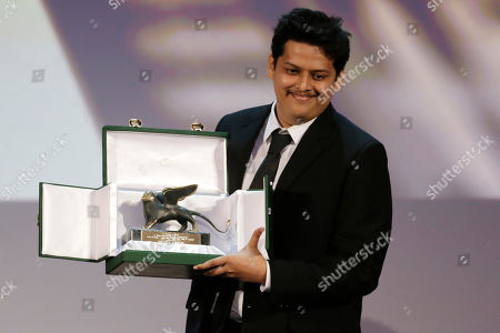 Director Chaitanya Tamhane poses for photographers with the Lion of the Future Award for his movie Court during the awards ceremony of the 71th edition of the Venice Film Festival in Venice, Italy