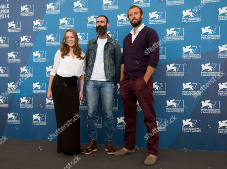 From left, actress Charlotte Spencer, director Duane Hopkins and actor Benjamin Dilloway pose during a photo call for the 'Bypass' movie at the 71st edition of the Venice Film Festival in Venice, Italy