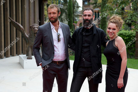 From left, actor Benjamin Dilloway, director Duane Hopkins and actress Charlotte Spencer pose for photographers as they arrive for the screening of Bypass at the 71st edition of the Venice Film Festival in Venice, Italy