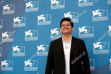 Director Chaitanya Tamhane poses for photographers during a photo call for Court at the 71st edition of the Venice Film Festival in Venice, Italy