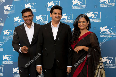From left, actor Vivek Gomber, director Chaitanya Tamhane and actress Geetanjali Kulkarni pose for photographers during a photo call for Court at the 71st edition of the Venice Film Festival in Venice, Italy