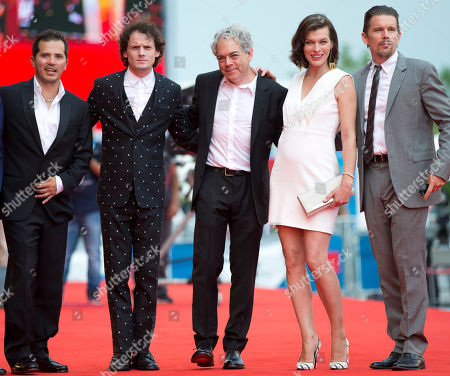 From right, actor Ethan Hawk, actress Milla Jovovich, director Michael Almereyda, actor Anton Yelchin and actor John Leguizamo pose for photographers as they arrive for the screening of Cymbeline at the 71st edition of the Venice Film Festival in Venice, Italy
