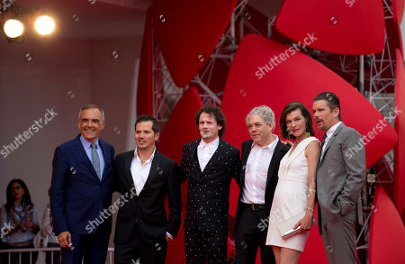 Stock Picture of From right, actor Ethan Hawk, actress Milla Jovovich, director Michael Almereyda, actor Anton Yelchin, actor John Leguizamo and festival director Alberto Barbera pose for photographers as they arrive for the screening of Cymbeline at the 71st edition of the Venice Film Festival in Venice, Italy