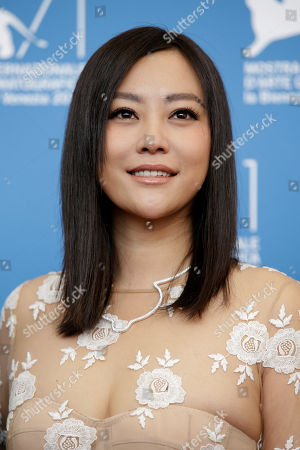 Actress Hao Lei poses for photographers during a photo call for Dearest at the 71st edition of the Venice Film Festival in Venice, Italy
