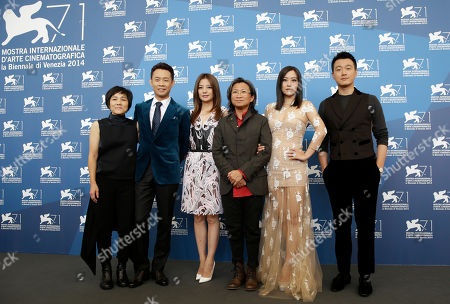 Stock Picture of From left, actress Sandra Ng, actor Zhang Yi, actress Zhao Wei, director Peter Ho-Sun Chan, actress Hao Lei and actor Tong Dawei pose for photographers during a photo call for Dearest at the 71st edition of the Venice Film Festival in Venice, Italy