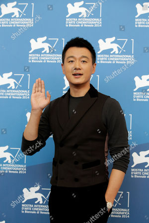 Stock Image of Actor Tong Dawei poses for photographers during a photo call for Dearest at the 71st edition of the Venice Film Festival in Venice, Italy