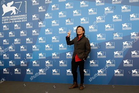 Director Peter Ho-Sun Chan poses for photographers during a photo call for Dearest at the 71st edition of the Venice Film Festival in Venice, Italy
