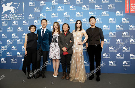 Stock Photo of From left, actress Sandra Ng, actor Zhang Yi, actress Zhao Wei, director Peter Ho-Sun Chan, actress Hao Lei and actor Tong Dawei pose for photographers during a photo call for Dearest at the 71st edition of the Venice Film Festival in Venice, Italy