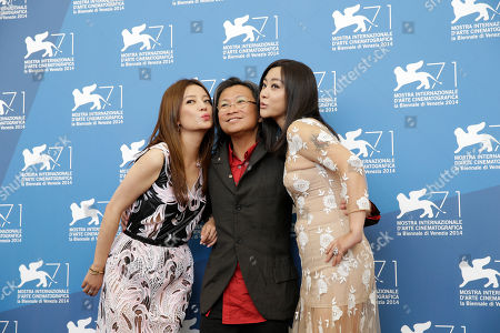 From left, actress Zhao Wei, director Peter Ho-Sun Chan and actress Hao Lei pose for photographers during a photo call for Dearest at the 71st edition of the Venice Film Festival in Venice, Italy