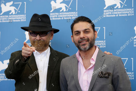 Stock Image of Habib Rezaei, Peyman Moaadi Habib Rezaei and Peyman Moaadi pose for photographers at the photo call for the movie Ghesseha during the 71st edition of the Venice Film Festival in Venice, Italy
