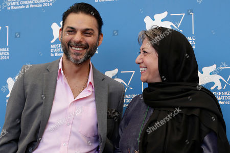 Peyman Moaadi and Rakhshan Bani-E'temad pose for photographers at the photo call for the movie Ghesseha during the 71st edition of the Venice Film Festival in Venice, Italy
