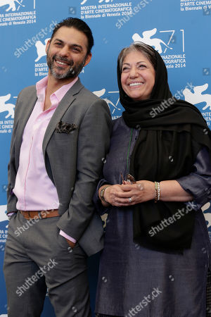 Stock Picture of Peyman Moaadi and Rakhshan Bani-E'temad pose for photographers at the photo call for the movie Ghesseha during the 71st edition of the Venice Film Festival in Venice, Italy