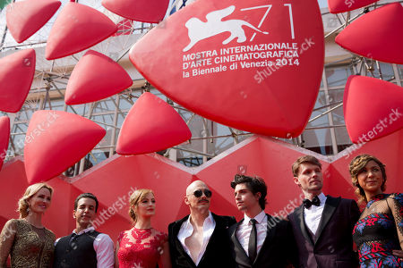 Actor and director James Franco, center, actor Scott Haze, second from right, actor Jacob Loeb, third from right, actress Ahna O'Reilly, third from left, and actress Janet Jones Gretzky, left, pose for photographers prior to James Franco receiving the Glory To The Filmmaker Award and the screening of The Sound and the Fury at 71st edition of the Venice Film Festival in Venice, Italy