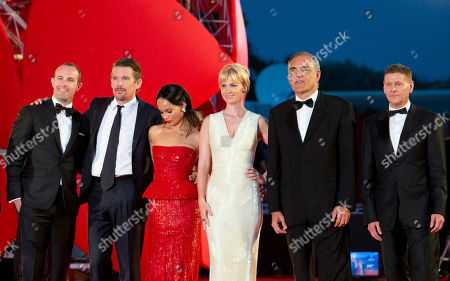 From right, director Andrew Niccol, festival director Alberto Barbera, actress January Jones, actress Zoe Kravitz, actor Ethan Hawke, and producer Zev Foreman pose for photographers as they arrive for the screening of Good Kill at the 71st edition of the Venice Film Festival in Venice, Italy