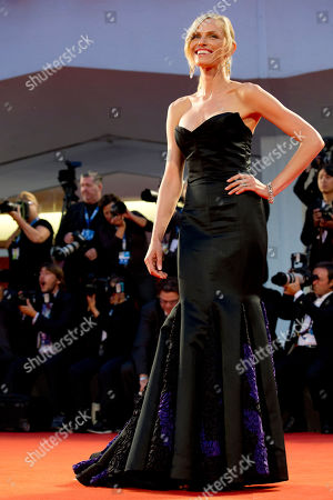 Actress Rachel Roberts poses for photographers as she arrives for the screening of Good Kill at the 71st edition of the Venice Film Festival in Venice, Italy