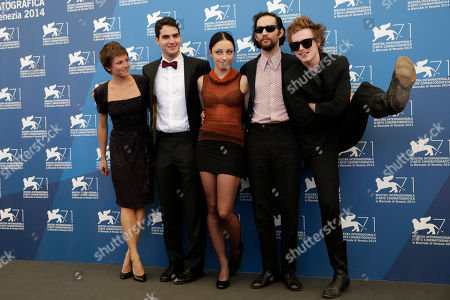 Stock Photo of From left, actress Eleonore Hendricks, director Ben Safdie, actress Arielle Holmes, director Joshua Safdie, and actor Caleb Landry Jones pose for photographers during the photo call for the movie Heaven Knows What at the 71st edition of the Venice Film Festival in Venice, Italy