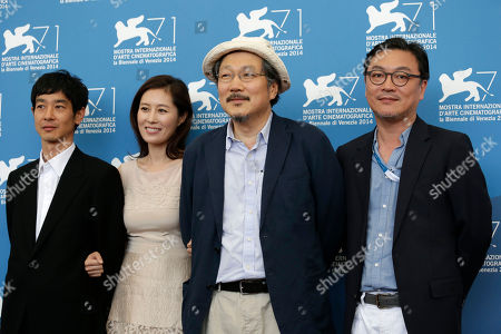From left, actor Ryo Kase, actress Moon So-ri, director Hong Sang-soo and actor Kim Eui-Sung pose for photographers during a photo call for Hill of Freedom (Jayueui Onduk) at the 71st edition of the Venice Film Festival in Venice, Italy