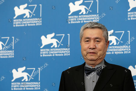 Director Im Kwon-taek poses for photographers during the photo call for the movie Hwajang at the 71st edition of the Venice Film Festival in Venice, Italy