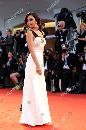 Federica De Cola Actress Federica De Cola poses for photographers as she arrives for the screening of Il Giovane Favoloso at the 71st edition of the Venice Film Festival in Venice, Italy