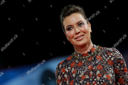 Actress and director Sabina Guzzanti arrives for the screening of the movie La Trattativa, at the 71st edition of the Venice Film Festival in Venice, Italy