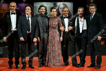 Actress and director Sabina Guzzanti, at center with the cast of the movie, arrives for the screening of the movie La Trattativa, at the 71st edition of the Venice Film Festival in Venice, Italy