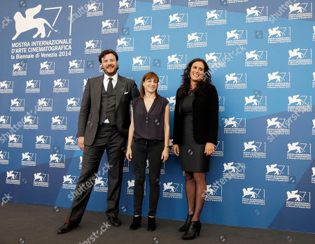 From left, director Ami Canaan Mann and producers John Jenks and Molly Hassell pose for photographers during the photo call for the movie Jackie and Ryan at the 71st edition of the Venice Film Festival in Venice, Italy