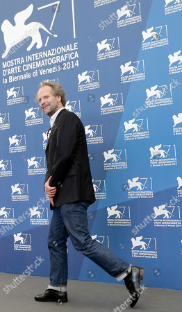 Stock Image of Philip Groning Member of the Venice 71 Jury Philip Groning leaves after a photo call at the 71st edition of the Venice Film Festival in Venice, Italy