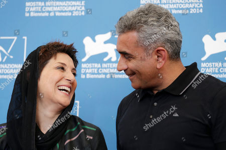 Director Elchin Musaoglu, right, and actress Fatemeh Motamed Arya pose for photographers during a photo call for Nabat at the 71st edition of the Venice Film Festival in Venice, Italy