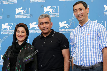 From left, actress Fatemeh Motamed Arya, director Elchin Musaoglu, and producer Mushfiq Hatamov pose for photographers during a photo call for Nabat at the 71st edition of the Venice Film Festival in Venice, Italy