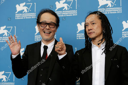 Actors Tatsuya Nakamura, right, and Lily Franky poses for photographers during a photo call for Nobi (Fires on the Plain) at the 71st edition of the Venice Film Festival in Venice, Italy